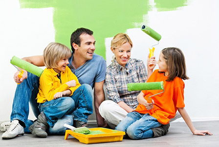 family-painting-a-room-together