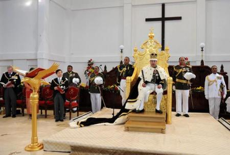 Comfortably occupying his 2.5 metre high golden throne made in China.
