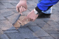 Wind damage to your roof in Garland TX? Get a free roof inspection