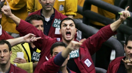 FILE - In this March 22, 2005 file photo, Damon Federighi shouts orders in the euro dollar futures pit at the Chicago Mercantile Exchange. Floor trading has shrunk to a fraction of its volume from two decades ago as faster, cheaper, computers take over the process of establishing prices on everything from pigs to Exxon Mobil's stock. (AP Photo/M. Spencer Green, File)