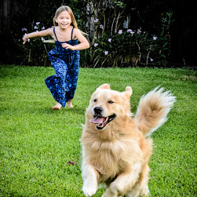dog running with girl