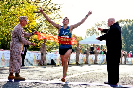 Air Force 2nd Lt. Jacob Bradosky crosses the finish line to win the 35th annual Marine Corps Marathon Oct. 31. Bradosky, 23, finished the 26.2 mile journey in 2:23:30. The Centerville, Ohio native is stationed at Vandenberg Air Force base in California.
