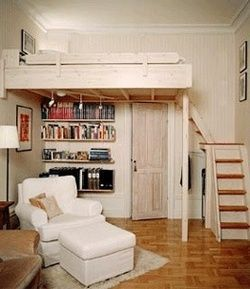 garage converted in to a sleeping area with a loft