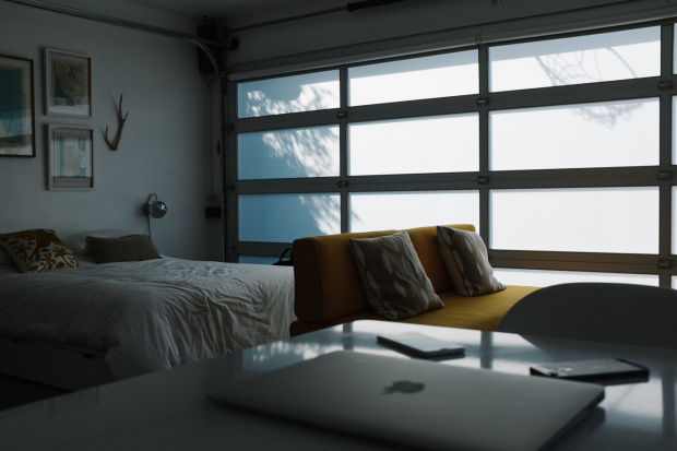 This photo shows the interior of a studio apartment that was a garage conversion. SOURCE: http://www.airows.com/travel/coolest-airbnb-in-los-angeles