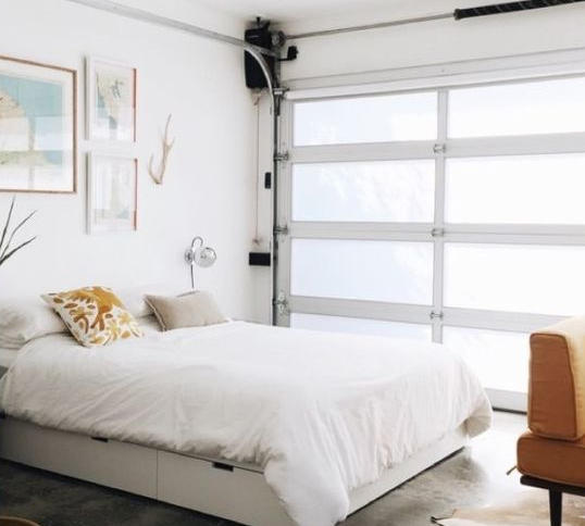 1. Make just enough changes so that the garage in Phoenix can be used as a sleeping area, but is still legally a garage. (To block the view of the garage door, you can use screens, drapes, or a wardrobe closet).