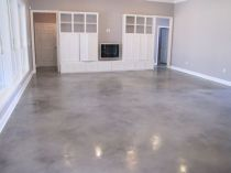 garage-with-natural-light-new-flooring-new-storage-cabinets