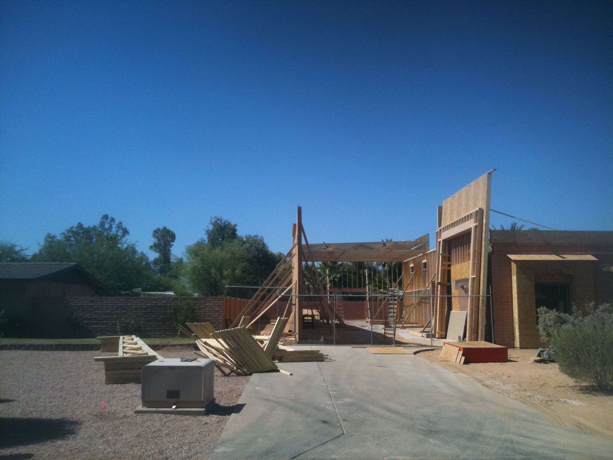Here is the next stage, with the rear wall of the garage and the second side wall (to the left). Note that on the right of the photo, the front wall of the RV garage (where the garage door will be) has already been framed and that section is leaning at a slight angle.