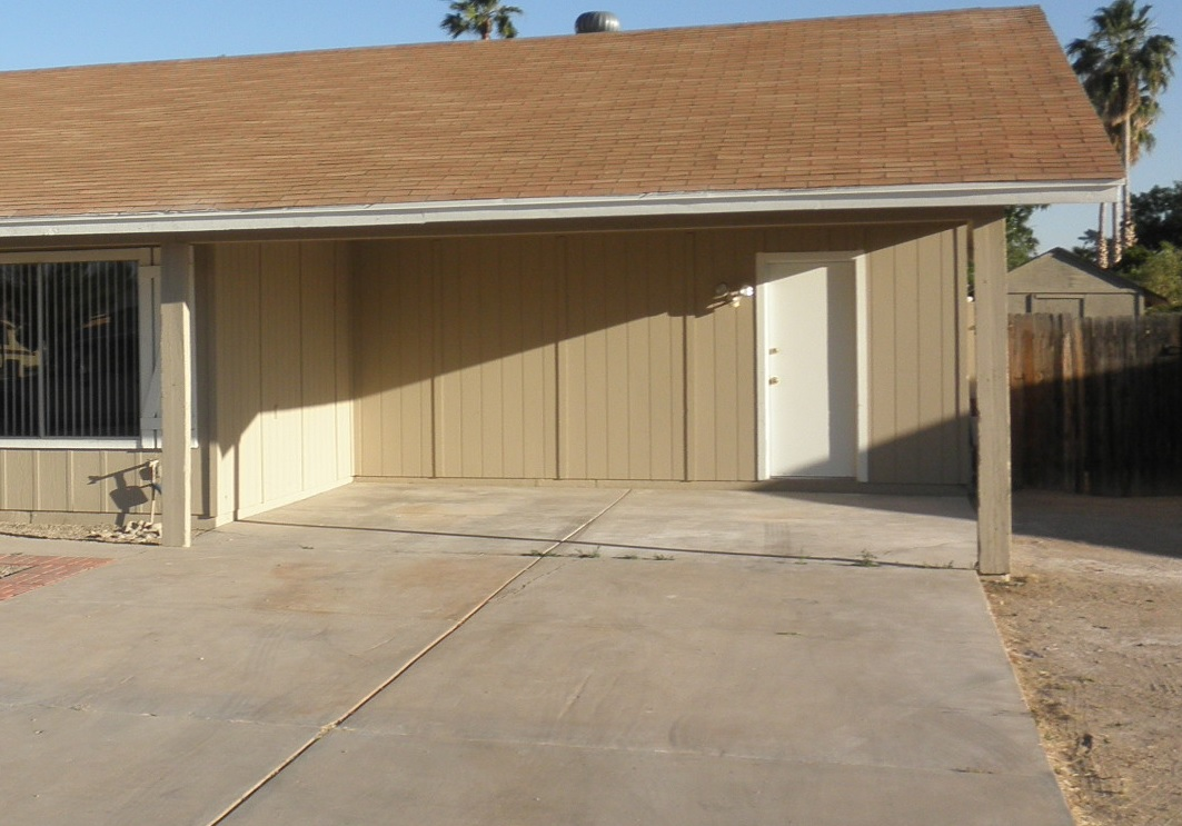 Building an enclosed garage from a carport