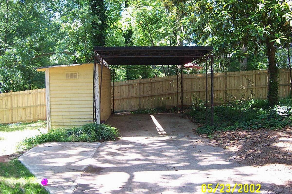 This carport was replaced with an enclosed 2-car garage.